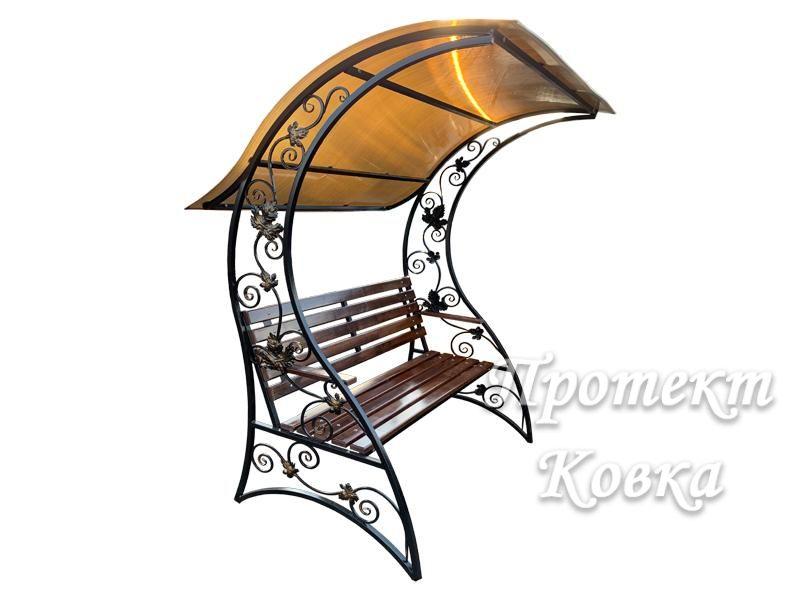 Про кованые садовые скамейки с навесом